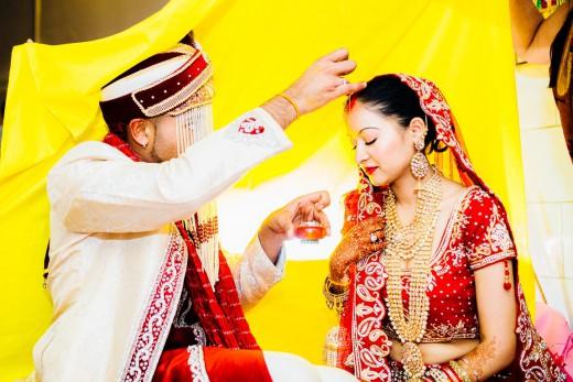 Hindoestaanse bruidsfotografie huwelijk bruiloft vivaah receptie eerste dans van Kiran en Sujata in Den Haag